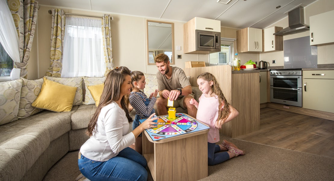 Family in lounge ¦ Gold caravan