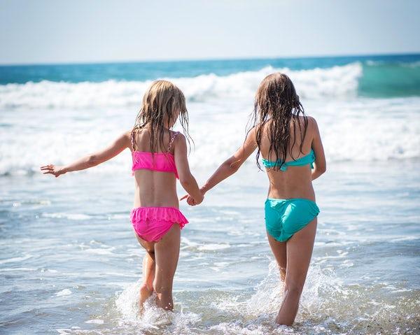 Girls on beach in Cornwall