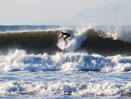 Surfer at Croyde Bay, Devon